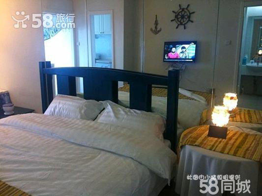房间内部情况: 海洋主题客房,地中海风格,品牌木地板,局部地毯,精品